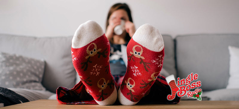 person on couch wearing Christmas socks